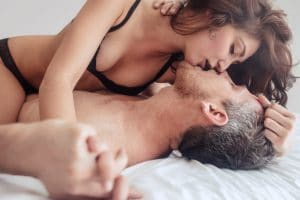 Sensual lovers in bed making love